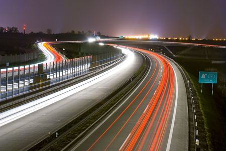 city lights: Night highway - long exposure - light lines