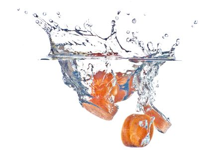 Red carrot abstract splashing in the clear blue water - isolated on white background Stock Photo - 6002272