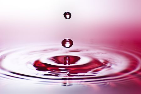 Red water environmental abstract background - red water drop splashing in clear clean water Stock Photo - 6904942