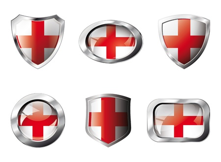 England set shiny buttons and shields of flag with metal frame. Isolated abstract object against white background. photo