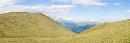 Panorama background in Carpathians. Beautiful mountains and landscape in Romania. photo