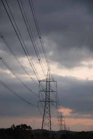 electricity providers: Voltage pylon  with transmission lines  transfering electrical energy to the public  Stock Photo