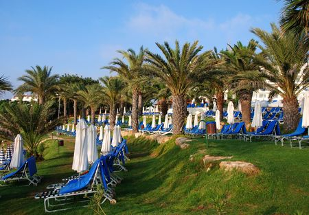 Beach umbrellas and deckchairs waiting for the tourists to arrive  at a Hotel in Cyprus.                         photo