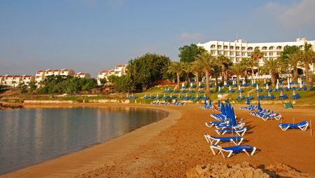 Empty beach with golden sand early in the mornning at Protaras area in Cyprus                  photo