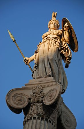 Athena god statue in front of Athens unicersity during evening light.