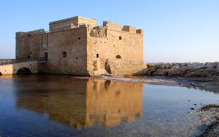 Paphos castle at paphos harbour in Cyprus late in the evening Stock Photo