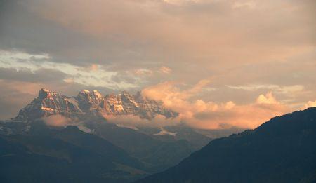 Alps mountain in Switzerland during evening light                                     photo