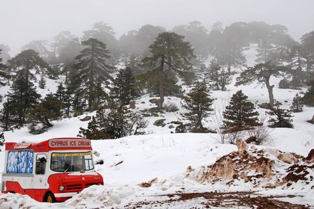 Winter scenic just before a snowstorm with an abandoned ice cream vehicle  Stock Photo - 2283259