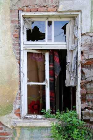 Old windows with broken glass. on an old wall Stock Photo - 2374147