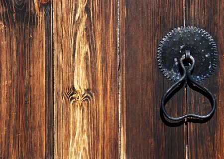 portico:                           Door handle on an ancient wooden door