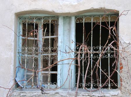 Old windows with broken glass. on an old wall Stock Photo - 2478919