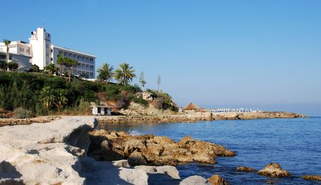 Beach hotel on a rocky beach at Paphos area in Cyprus. photo