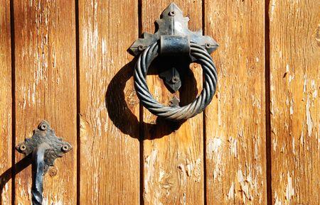 doorhandle:                 Wooden vintage door with metallic doorhandle