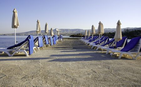 Empty tropical beach chairs from a holiday resort in Cyprus. photo