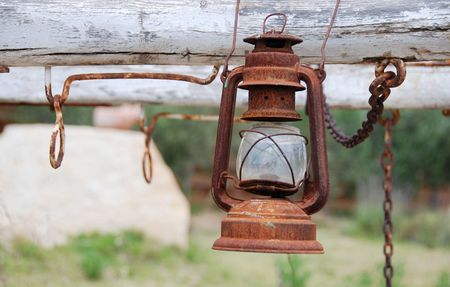 oillamp:                                     View of a rusty oil lamp hanging on a western carriage Stock Photo