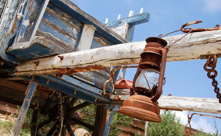 oillamp:                           Old wooden carriage reminding far west times