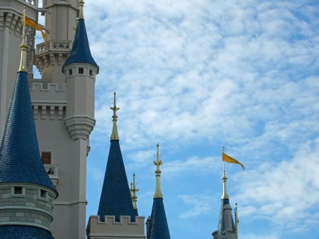 Magic castle towers against a wonderful cloudy sky Stock Photo