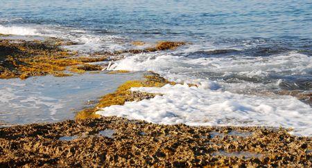 Rocky coast with sea waves hitting the rocks                              Stock Photo - 3283406