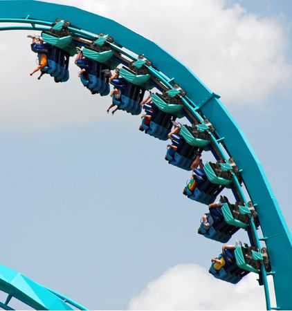 Roller Coaster with people taking a ride.                       photo