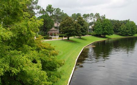 By the river side. View of a holiday resort gardens in Orlando FL.