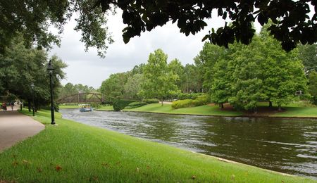 View of the gardens of a holiday resort  in Orlando FL with the river passing.