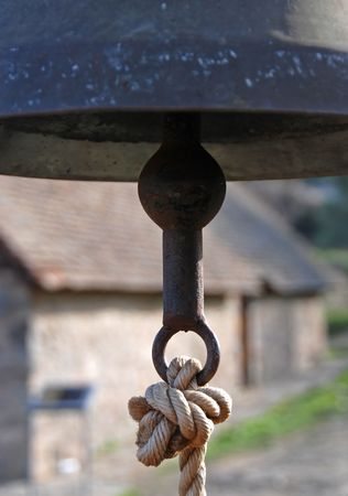 peal: Belfry with bronze bell and a rope fastened on the bell     Stock Photo