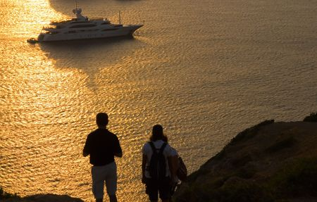 idealistic: Two people are enjoyng sunset at cape Sounio in Greece.