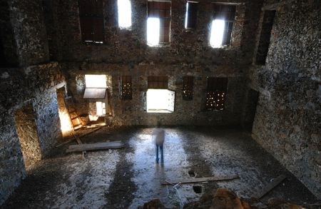 abandoned room: Scary room  with many windows and a man acting as a ghost