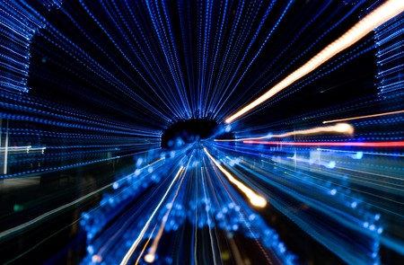 distorted image: Motion of blue lights creating a tunnel.