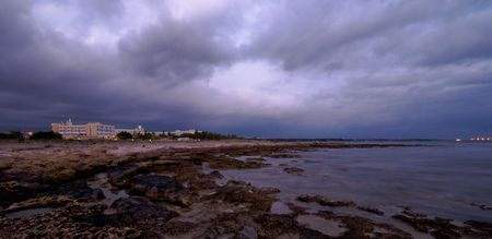 Coast view during sunset with a dramatic moody sky at Paphos area in Cyprus.  photo