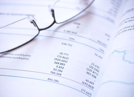 Financial statement and eye glasses.