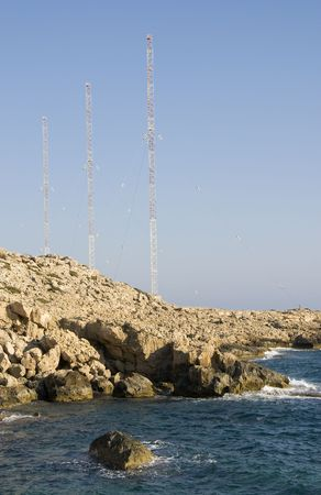 greco: Transmission Antennas on a rocky coast. Area is Cape Greco area near Ayia Napa in Cyprus