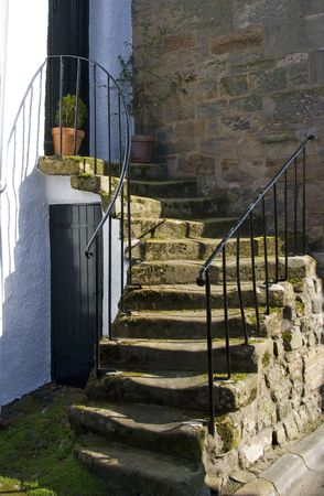 Home antrance via a stone staircase from St. Andrews house in Scotland photo