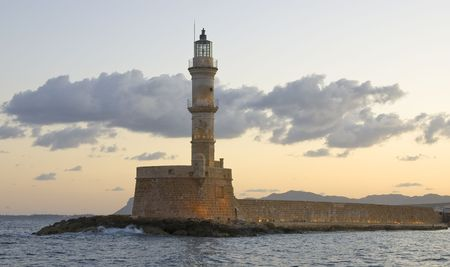 Chania Lighthouse in old town port  early in the morning Stock Photo - 5827549