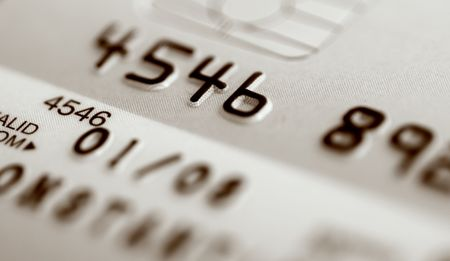 Credit card with numbers and a shallow depth of field with split tone effect added.