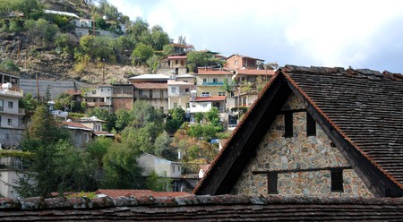 Kalopanayiotis mountain  village at Troodos area in Cyprus. The church in the front is the famous Agios Ioannis Lampadistis. Stock Photo