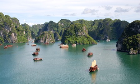 Cruise tourist boats at Halong bay in Vietnam. Halong bay is made of 3000 limestone islands.  photo