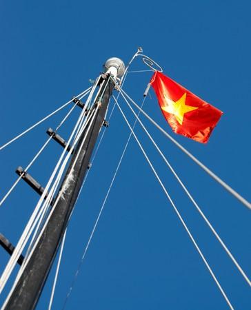 Sailing ship mast with vietnamese flag photo