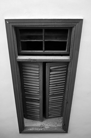 entranceway: Broken wooden window in monochrome from a building in Nicosia, Cyprus