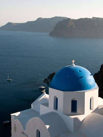 Christian church with blue dome at Santorini island in Greece.  Stock Photo