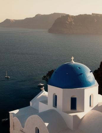 Christian church with blue dome at Santorini island in Greece.  photo