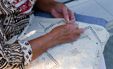 Adult woman is making a traditional embroidery at Lefkara village in Cyprus