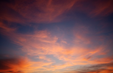 dawn sky: Background of a cloudscape in red color