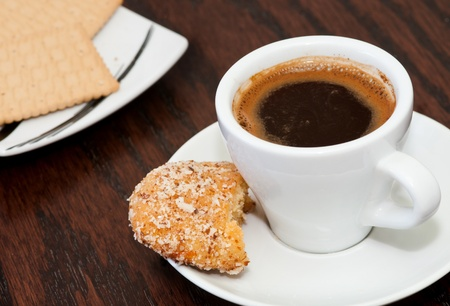 Cup of delicious coffee with biscuits.