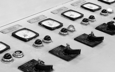 Electricity control panel with clocks measuring and controlling electricity and buttons. Stock Photo