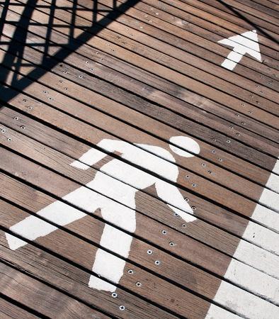 Pedestrian sign on a wooden  lane.