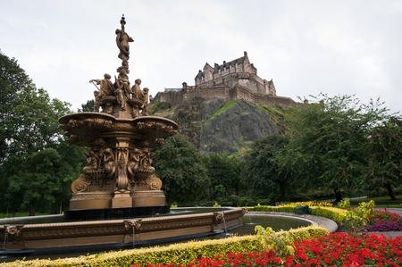 View of Edinburgh castle from princess gardens with the famous fountain