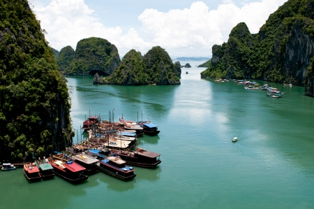 Tourist boats at Halong bay in Vietnam, Asia photo
