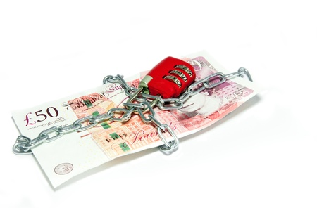 British fifty  pounds note with padlock and metal chain  Concept of saving money or money crisis  photo