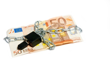 Fifty Euro note with metal chain and padlock  Concept of money security, savings or even European Union money crisis  photo